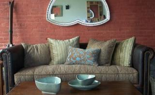 Living room with Leather couch, mirror, coffee table